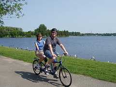 image of a couple biking one of the cheap, fun things to see and do in Ottawa