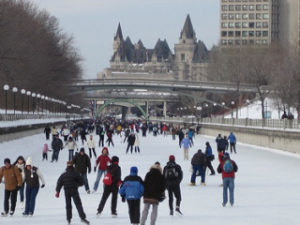 image of people skating on the Rideau Canal on of the free, affordable things you can do in Ottawa