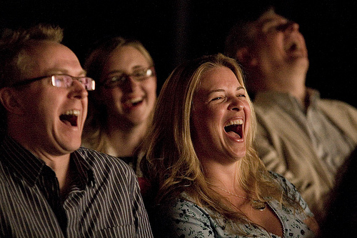 image of people laughing at the Absolute Comedy Club one of the fun, cheap, free things to do in Kingston, Ontario
