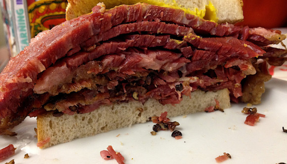 image of smoked meat sandwich one of the best cheap eats foods to get in montreal