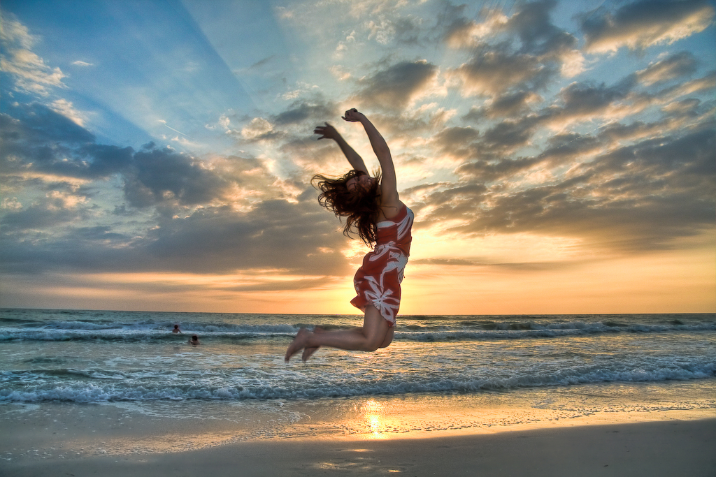 image of a woman jumping for joy after using YYZ Deals to Find the Best Flight Deal on a Cheap Trip from Toronto