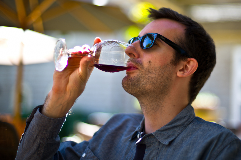 image of a man tasting wine at one of the affordable wine tours in niagara falls ontario canada