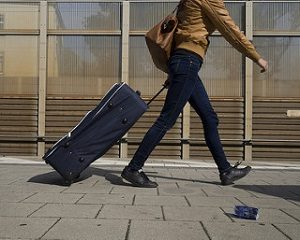 image of someone pulling their luggage to the airport after searching YYZ Deals and finding a flight deal on a cheap trip from Toronto