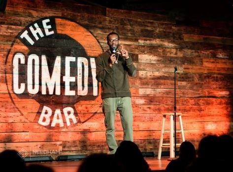 stand up comedian performs at the comedy car one of the cheap, fun things to do in Chicago