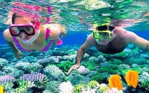 people snorkeling at the cheap, all-inclusive Fiesta Americana Holguin Costa Verde resort in Cuba