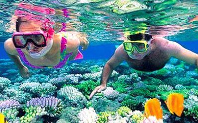 people snorkeling at the cheap, all-inclusive Fiesta Americana Holguin Costa Verde resort in Cuba