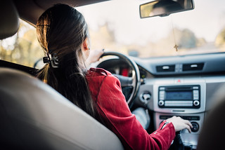 woman having a cheap winter getaway by driving somone elses car down to Florida